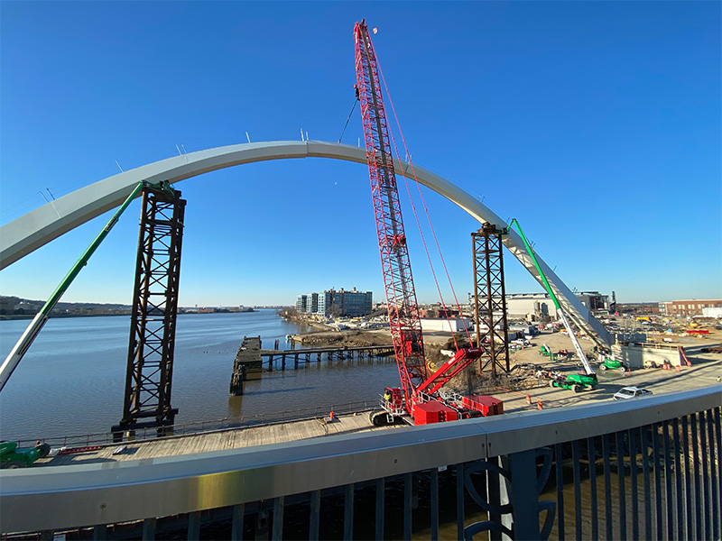 Slings being used to lift heavy bridge piece in washington DC